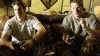 Prince Harry, right, playing video games in Afghanistan