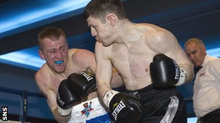 Eddie Doyle feels the weight of Willie Limond's punches