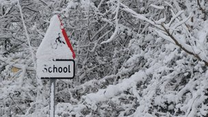 School sign covered in snow