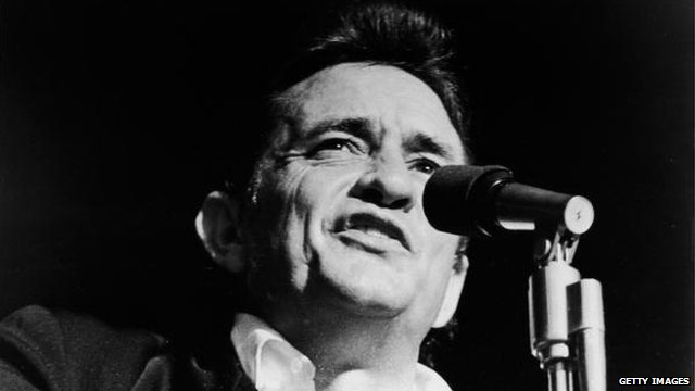 Johnny Cash performing on stage in 1969
