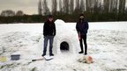 Men standing with an igloo in Lambley