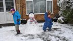 Boys with a snowman in Arnold