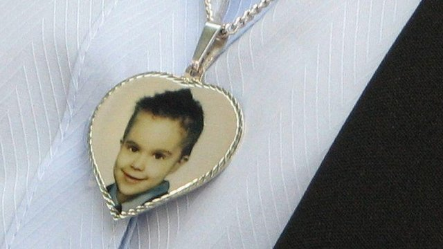A necklace worn by Sharon Mills, carrying a picture of her son Mason Jones