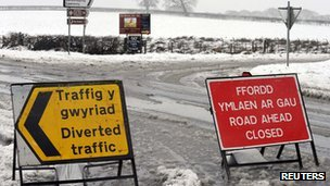 Temporary signs stand on the A4075 road near Martletwy, closed due to heavy snowfalls