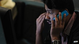 A stockbroker watching share prices on a monitor during a trading session at the Karachi Stock Exchange