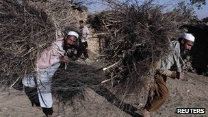 People carrying wood on the outskirts of Islamabad