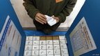 An Israeli soldier prepares a voting booth at an army base, 21 January 21 2013 in Shekef, Israel.