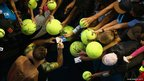 Andy Murray with tennis balls