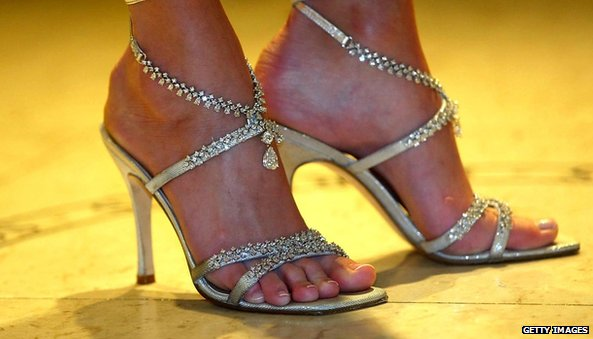 A pair of Diamond and Platinium shoes modelled by Heidi