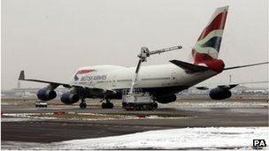 A plane being de-iced at Heathrow