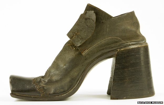 A man&#039;s high-heeled shoe 