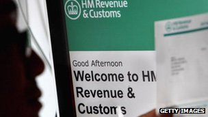 HM Revenue and  Customs - man looking at forms