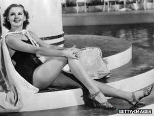 Jane Hamilton modelling a swimsuit in heels, 1938