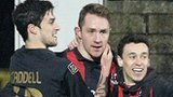 Declan Caddell, Timmy Adamson and Paul Heatley celebrate taking the lead against Linfield