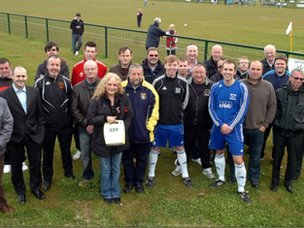 Paul Lunt presents the FA with their defibrillators
