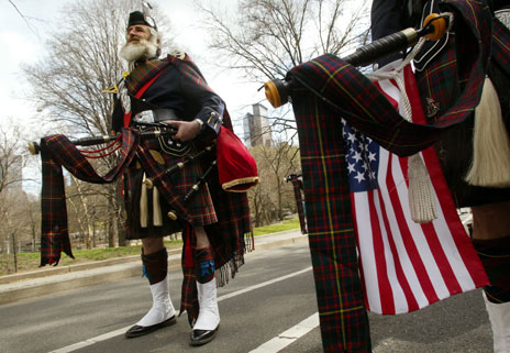 Pipers in kilts with US flags
