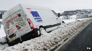 Van lays in the snow after coming off the Pickering to Whitby road near Lockton, North Yorkshire