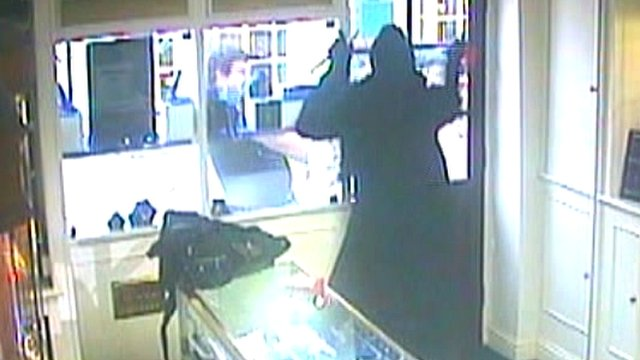 Raider smashing his way out of jewellery shop