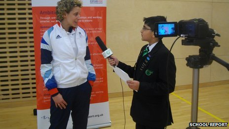 A school reporter interviews volleyball player Maria Bertelli