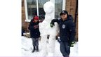 Two boys with their snow alien.