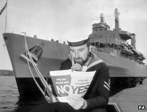 A British sailor, LREM Eric Littlehales, studies referendum leaflets while on a visit to Stockholm aboard HMS Fearless, 27 May 1975 