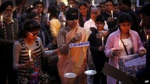 An Indian girl in the middle dressed as Lady Justice takes part in a candlelight vigil in Delhi for speedier trials in rape and sexual violence cases.
