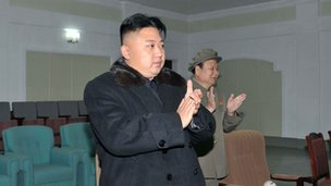 North Korean leader Kim Jong-Un claps his hands to celebrate the launching of the rocket on 12 December 2012 at the general satellite control and command centre in Pyongyang