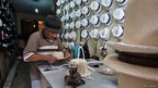 Man making a hat