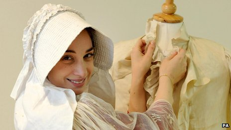 Model Joy Asfar posing with costumes similar to the outfits that would have been worn by Mr Darcy and Elizabeth, characters in Jane Austen's novel Pride and Prejudice.