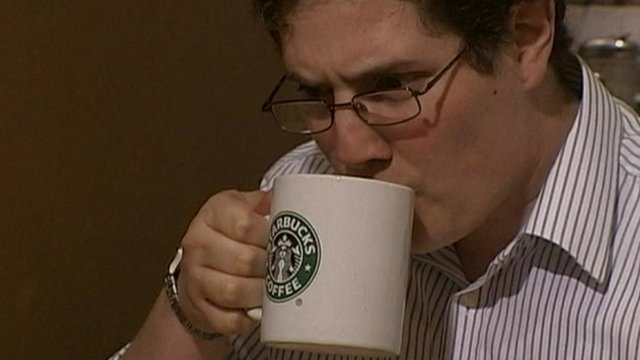 Man drinking from Starbucks mug