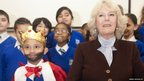 The Duchess of Cornwall with child dressed as a king