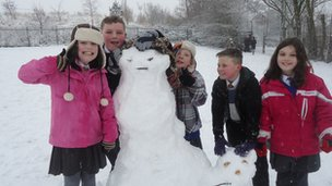Children at St Marys RC Primary School with their snowman