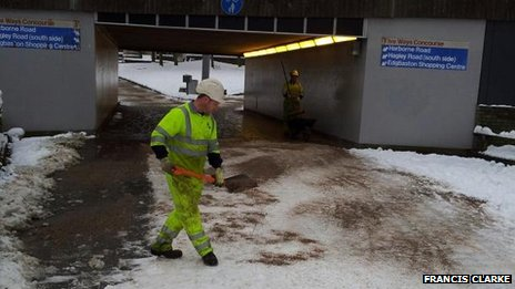 Amey workers helping to grit footpaths near Five Ways in Birmingham