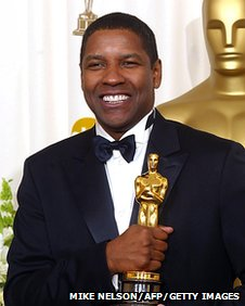 Denzel Washington with his Oscars in 2002