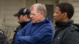 Robert Zemeckis and Denzel Washington on the set of Flight. Copyright Paramount Pictures.