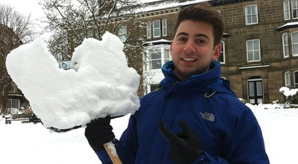 Ricky Boleto with a shovel full of snow.