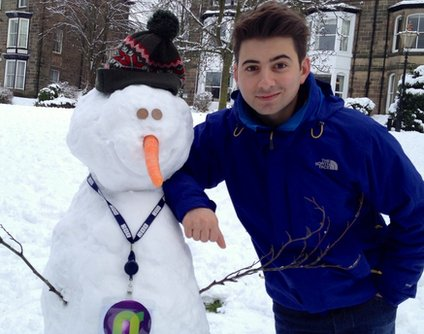 Ricky with his finished snowman.