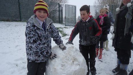 Children at St Marys RC Primary School build a snowman