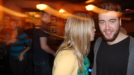 Jillian Rae Greenwood talking to a man at a nightclub in Ottawa, Canada