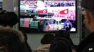People in Seoul watch TV news showing file footage of a North Korean rocket carried during a military parade. Photo: 24 January 2013