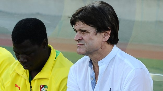 Togo coach Didier Six (right)
