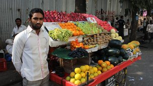 Street fruit seller with his cart in Mumbai