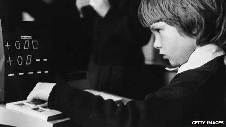 Boy using a school computer in 1981