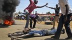 Protesters in Kisumu, Kenya, dance in front of a burning tyre - Sunday 20 January 2013