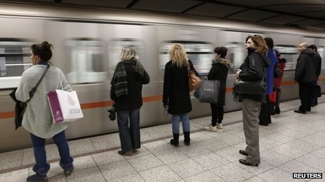 Passengers wait to board on a train at Syntagma metro station after the end of a nine-day strike in Athens, 25 January 2013