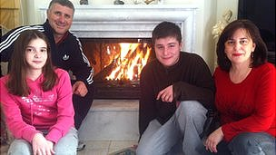 The Smirli family around their fire