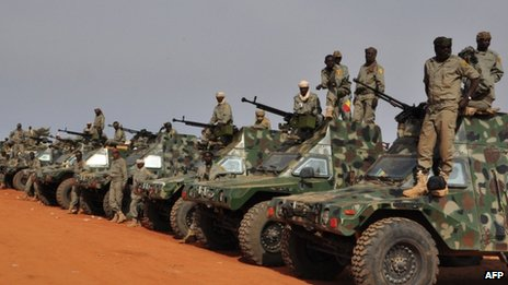 Chadian soldiers stand in front of their armoured vehicles as they prepare to leave a military camp on the outskirts of Niamey on 24 January  2013