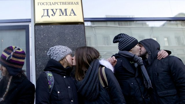Gay rights campaigners kiss each other during a protest outside of State Duma, Russian Parliament