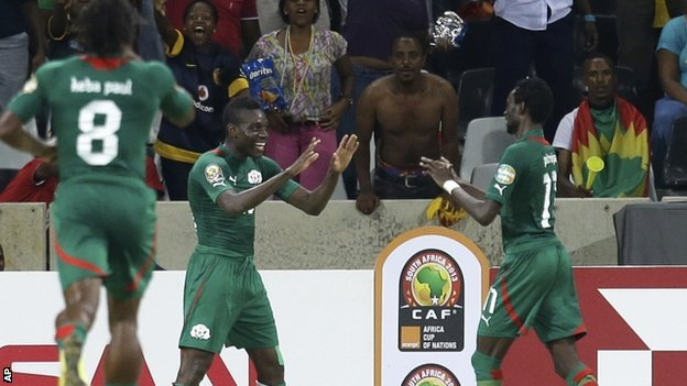 Alain Traore, center, celebrates scoring his opener  against Ethiopia