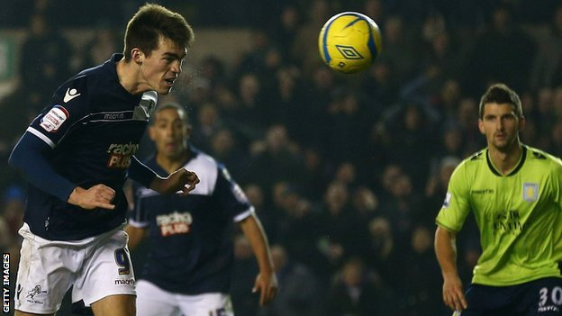 Millwall&#039;s John Marquis scores against Aston Villa